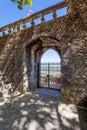 Porta do Sol Gate built into the medieval castle wall in Portas do Sol Garden. Royalty Free Stock Photo