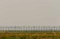 Porta na cerca with cloudy sky Fotografia de Stock Royalty Free