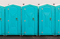 Porta pottie line up row of five potties Royalty Free Stock Photo