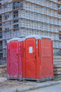 Porta potty at construction site used by workers the Stock Photos