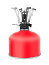Portable camping stove with a butane propane gas canister isolated on white background Royalty Free Stock Photography