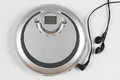 Portable cd player in silver with headphones Royalty Free Stock Photo