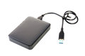 Portable external HDD hard disk drive with USB cable on white ba Royalty Free Stock Photo