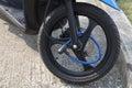 Portable lock on front wheel motocycle Royalty Free Stock Photo