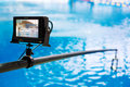Portable multiformat lcd monitor mounted on rod for shooting jumps into water Royalty Free Stock Photography