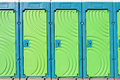 Portable toilets close up of toilet doors Stock Photo