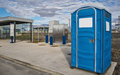 Portable toilets outdoors beside a suburban train statio Stock Image