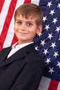 Portait of caucasian boy with american flag in background Royalty Free Stock Image