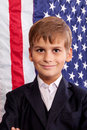 Portait of caucasian boy with american flag in background Stock Photography