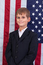 Portait of Caucasian boy with American flag Royalty Free Stock Photo