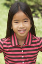 Portait Of Smiling Young Girl Outdoors Royalty Free Stock Photography