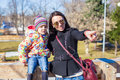 Portarit of little cute girl with her mother on sunny day outdoors Royalty Free Stock Images