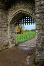 Portcullis in stone archway Royalty Free Stock Photo