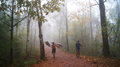 Porter on phukradung trail in thai fog season and rains Royalty Free Stock Image