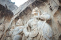 Porter`s statue rock carving at Longmen Grottoes, Luoyang, Henan
