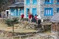 Porters of Himalaya Mountain expedition walking throw village