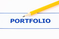 Portfolio text and pencil close up Royalty Free Stock Photos