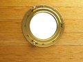 Porthole gold wood Stock Photo