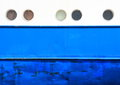 Portholes and hull on white and blue coaster background Royalty Free Stock Photography