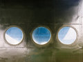 Portholes on old aircraft Royalty Free Stock Photo