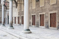 Portico with marble columns and doors in a row in the courtyard Royalty Free Stock Photo