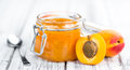 Portion of Apricot Jam on wooden background & x28;selective focus& x29;