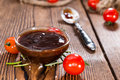 Portion of barbeque sauce close up shot on dark rustic background Royalty Free Stock Photos
