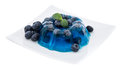 Portion of blueberry jello on white isolated background Stock Photo