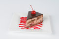 Portion of chocolate cake with cherry glazed one on top Stock Photography