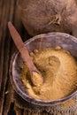 Portion of coconut sugar golden selective focus on vintage wooden background Royalty Free Stock Image