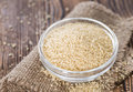 Portion of couscous close up shot on wooden background Royalty Free Stock Photos