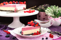 Portion of delicious raspberry cheesecake decorated with fresh berries and chocolate on dark Royalty Free Stock Images