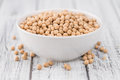 Portion of dried Chickpeas on wooden background, selective focus