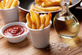 Portion of french fries with ketchup Royalty Free Stock Photos