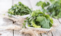 Portion of fresh cilantro on a table weathered wood Stock Photography