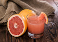 Portion of grapefruit juice fresh made Royalty Free Stock Images