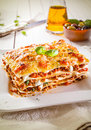 Portion of lasagne with bolognese and cheese traditional durum wheat bolognaise sauce beef mince in alternating layers on a white Stock Photography