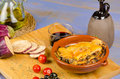 Portion of moussaka and some its ingredients Royalty Free Stock Photo