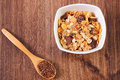 Portion of muesli and linseed concept of healthy nutrition and increase metabolism in glass bowl on spoon ingredients with dietary Stock Photos