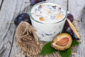 Portion of plum yoghurt with fresh fruits Royalty Free Stock Images