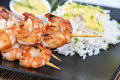 Portion of prawns with curry sauce skewered fresh made Royalty Free Stock Image