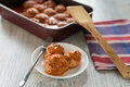 Portion of three meatballs on white plate Stock Photos