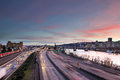 Portland downtown freeway rush hour traffic at sunset oregon with city skyline along interstate during evening Royalty Free Stock Images