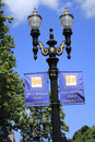 Portland oregon july two portland saturday sunday market signs hung below street lights trees beautiful sunny blue sky background Royalty Free Stock Photo