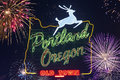 Portland oregon sign with deer and flashing fireworks on the sky in the background jumping image of s borders Royalty Free Stock Photo