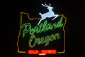 Portland oregon sign with jumping deer during night in and image of s borders Stock Image