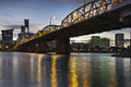 Portland oregon skyline under hawthorne bridge city by the bank of willamette river at dusk Royalty Free Stock Images