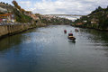 Porto city excursion boats on douro river and infante bridge portugal Royalty Free Stock Photography