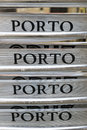 Porto the name of a portuguese city and its famous wine writing on the back of four chairs stacked aluminum Stock Photos