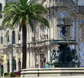 Porto a typical view of a fountain a church and a palm tree in downtown portugal is the second largest city in portugal it Stock Photography